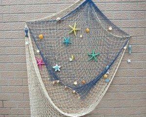 Nautical beach wedding planning theme ideas decor for Fishing net decor ideas