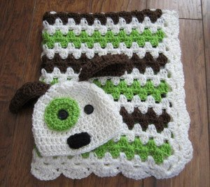 Crochet baby blanket with puppy dog hat